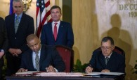 Anthony Foxx and Adel Yzquierdo Rodriguez Sign Agreement